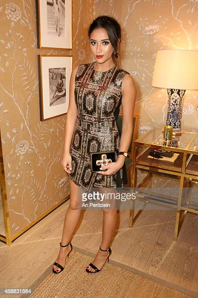 Actress Shay Mitchell attends Vogue and Tory Burch celebrate the Tory Burch Watch Collection at Tory Burch on November 11 2014 in Beverly Hills...