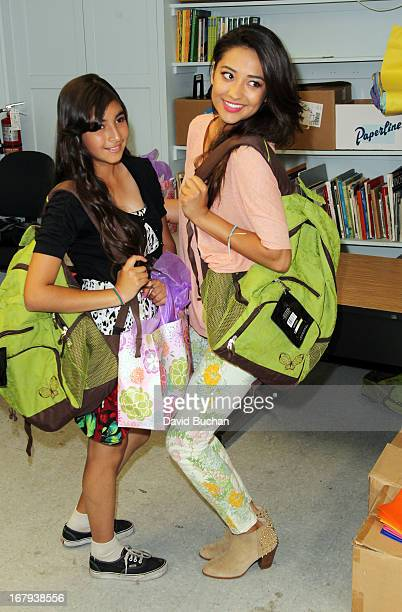Actress Shay Mitchell join 'Girl Power Day' and gives out gifts to graduating students from Ascension Catholic School on May 2 2013 in Los Angeles...
