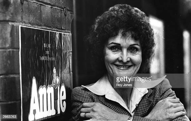 Actress Sheila Hancock in front of a poster of the show 'Annie'