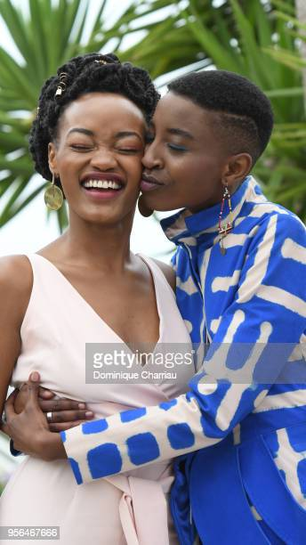 Actress Sheila Munyiva is kissed by actress Samantha Mugatsia attend the photocall for 'Rafiki' during the 71st annual Cannes Film Festival at Palais...