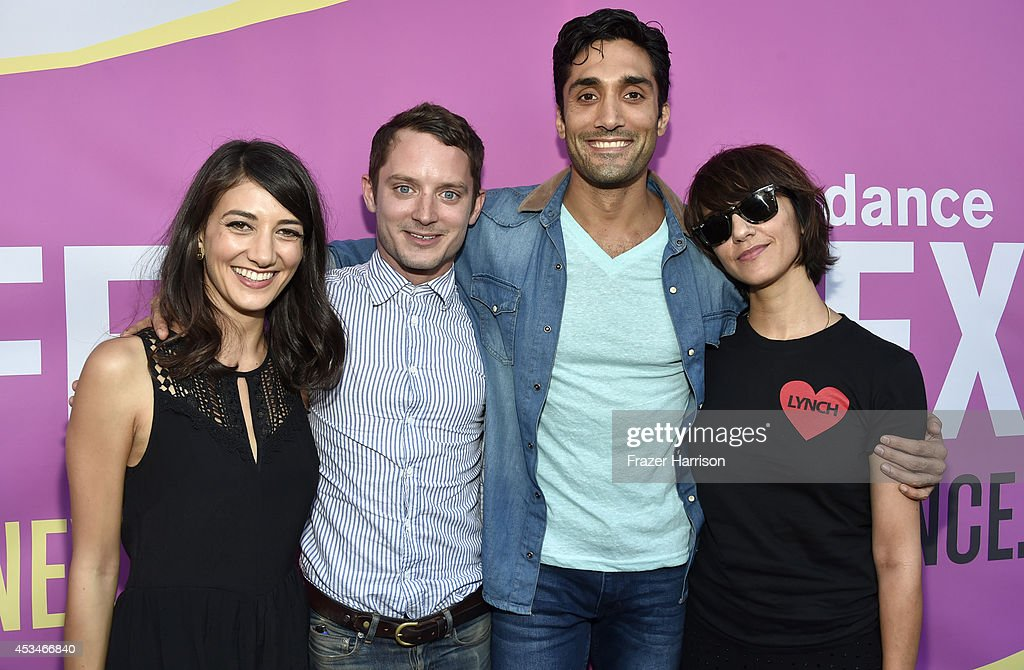 Actress Sheila Vand, producer Elijah Wood, actor Dominic Rains and director Ana Lily Amirpour attend the screening of 'A Girl Walks Home Alone at Night' with Warpaint in concert during Sundance NEXT FEST at The Theatre at Ace Hotel on August 10, 2014 in Los Angeles, California.
