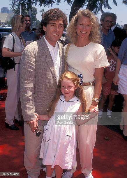 Actress Shelley Hack husband Harry Winer and daughter Devon Winer attend the House Arrest Westwood Premiere on July 20 1996 at the Veterans Wadsworth...