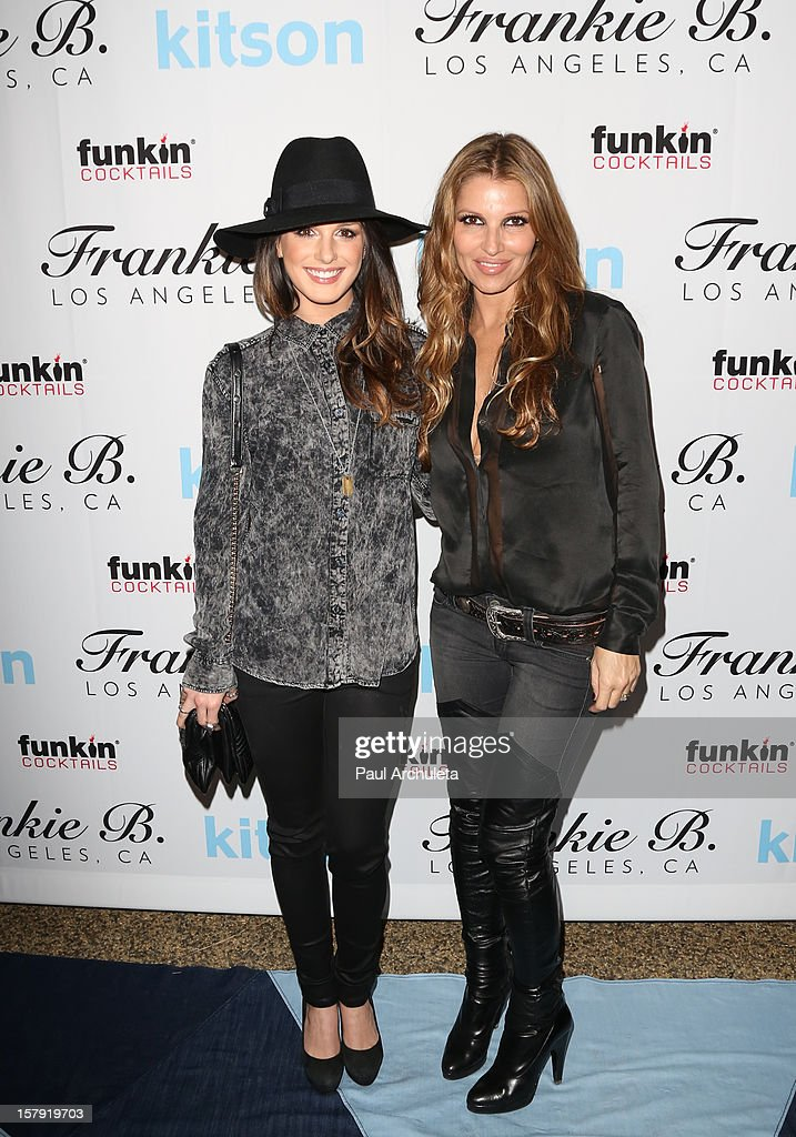Actress Shenae Grimes (L) and Danielle Clarke attend the Get Festive With Frankie B. and Kitson event at Kitson on Roberston on December 6, 2012 in Beverly Hills, California.