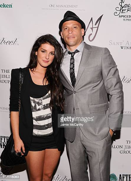 Actress Shenae Grimes and tattoo artist and TV personality Ami James attend the grand opening Wooster Street Social Club on June 22 2011 in New York...
