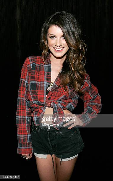 Actress Shenae Grimes attends MarieDolma Chophel's 'Invasive Ways' Exhibition Opening at What Goes Around Comes Around on May 18 2012 in the Brooklyn...