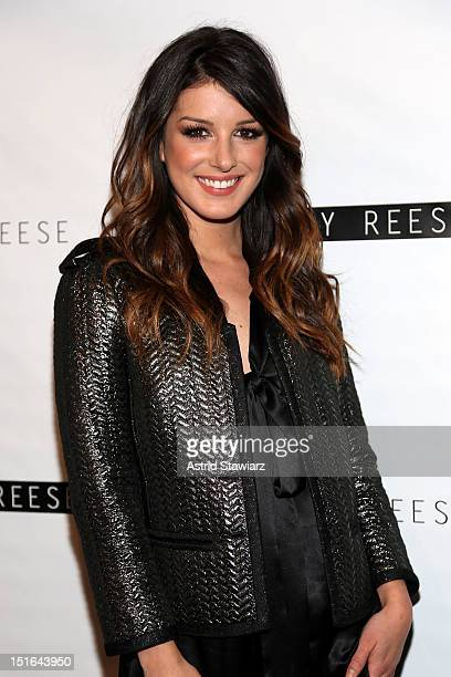 Actress Shenae Grimes poses backstage at the Tracy Reese Spring 2013 fashion show for TRESemme during MercedesBenz Fashion Week at The Studio at...