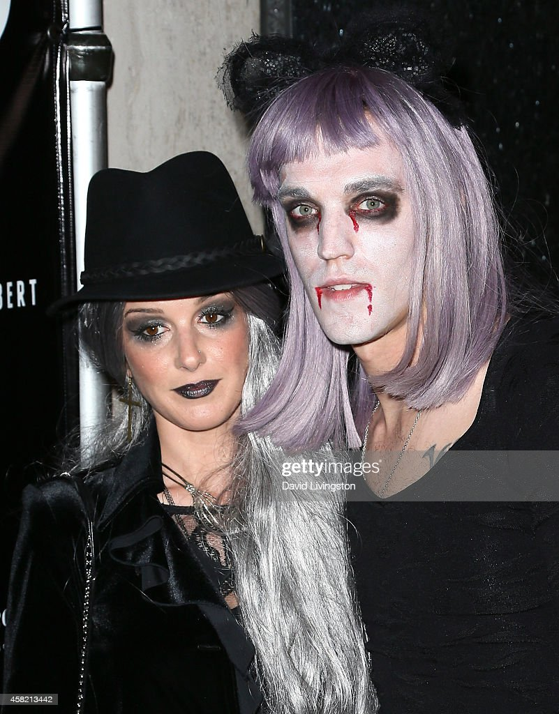 Actress Shenae Grimes-Beech (L) and husband musician Josh Beech attend Adam Lambert's 2nd Annual Halloween Bash at Bootsy Bellows on October 31, 2014 in West Hollywood, California.