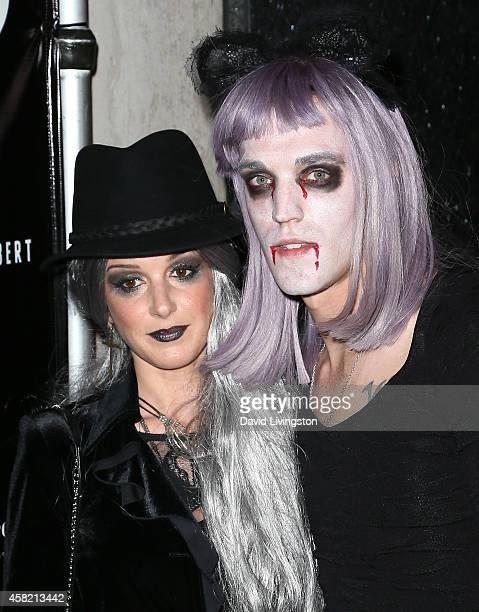Actress Shenae Grimes-Beech and husband musician Josh Beech attend Adam Lambert's 2nd Annual Halloween Bash at Bootsy Bellows on October 31, 2014 in...
