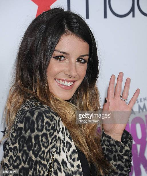 Actress Shenae GrimesBeech arrives at Macy's Passport Glamorama 'Fashion Rocks' at Create Nightclub on September 9 2014 in Los Angeles California