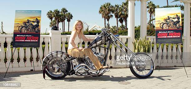 Actress Sheree Wilson poses on a motorcycle for the film The Easy Rider The Ride Back during opening day of the 2010 American Film Market at the...