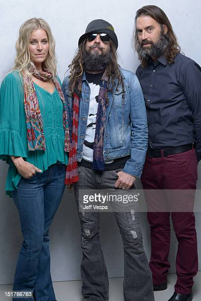 Actress Sheri Moon Zombie director Rob Zombie and Jeffrey Daniel Phillips of Lords Of Salem pose at the Guess Portrait Studio during 2012 Toronto...