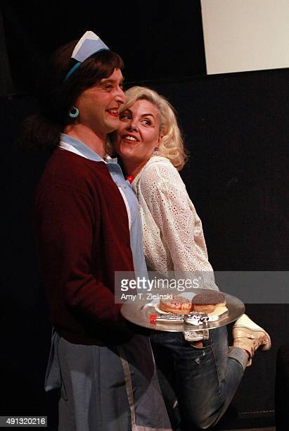 Actress Sherilyn Fenn who played on the TV series Twin Peaks the character Audrey Horne poses for pictures with a fan named Holly Mackerel dressed as...