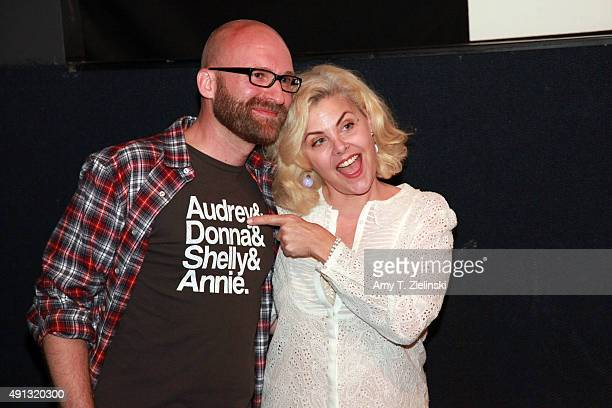 Actress Sherilyn Fenn who played on the TV series Twin Peaks the character Audrey Horne poses for pictures with a fan during the sixth annual Twin...
