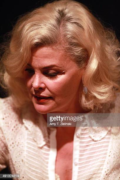 Actress Sherilyn Fenn who played on the TV series Twin Peaks the character Audrey Horne looks on as she signs autographs and poses for pictures for...