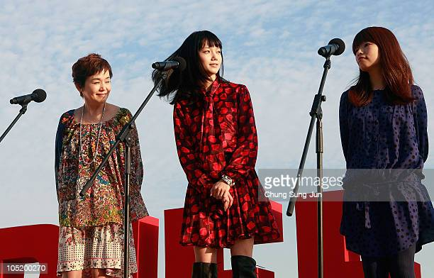 Actress Shinobu Otake Aoi Miyazaki and director Mipo O attend a Audience Meet and Greet 'Here Comes the Bride My Mom' at the Haeundae beach during...