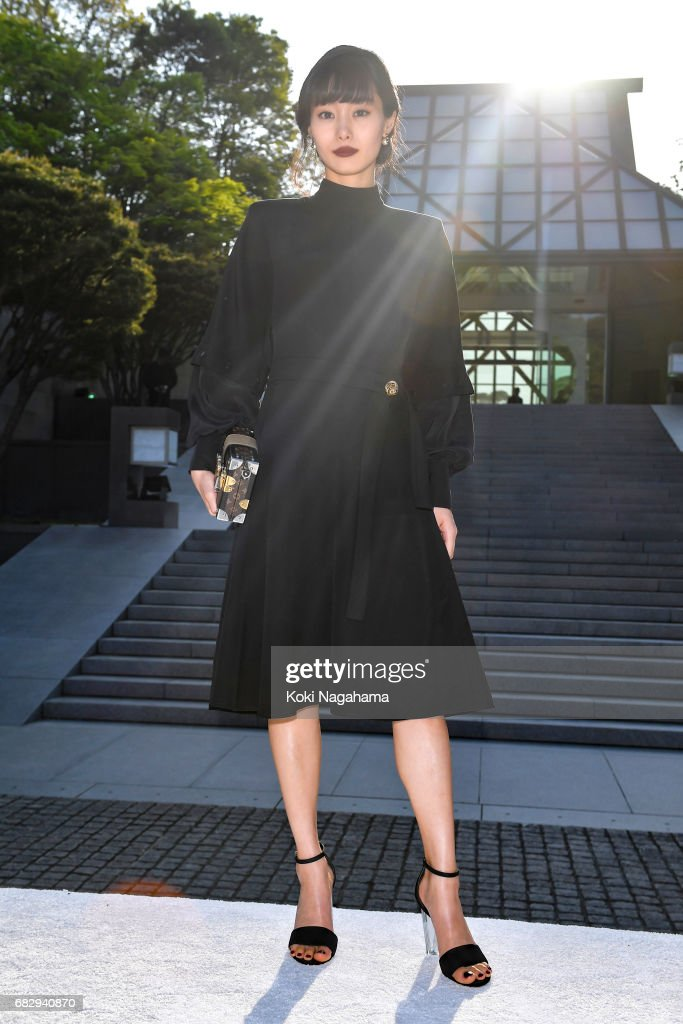 d4ad9346e3 Actress Shioli Kutsuna poses for photographs during the Louis ...
