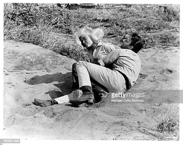 Actress Shirley Eaton and actor Harry Guardino on the set of the movie Rhino in 1964