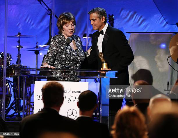 Actress Shirley MacLaine presents the Brass Ring Award to actor/honoree George Clooney onstage during the 26th Anniversary Carousel Of Hope Ball...