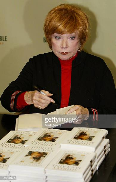 Actress Shirley Maclaine signs copies of her new book 'Out on a Leash' at Barnes and Nobles, Rockefeller Centre on October 21, 2003 in New York City.