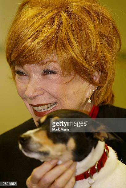 Actress Shirley Maclaine strokes a dog at a signing for her new book 'Out on a Leash' at Barnes and Nobles, Rockefeller Centre on October 21, 2003 in...