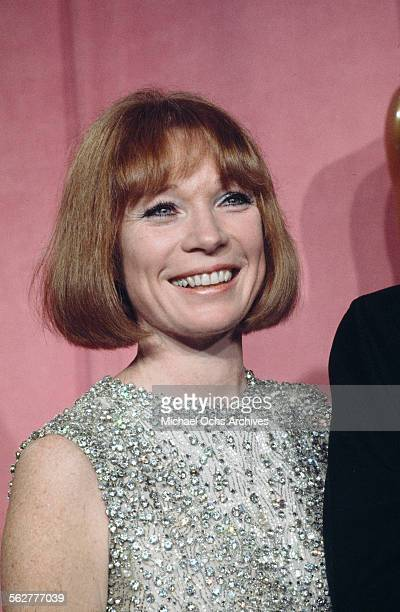 Actress Shirley MacLean poses backstage after presenting Best Director award during the 46th Academy Awards at Dorothy Chandler Pavilion in Los...