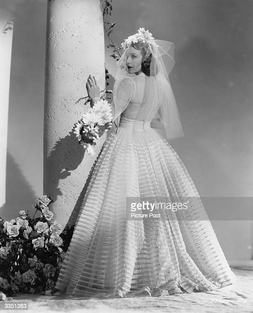 Actress Shirley Ross wearing the wedding dress used in the Paramount film 'Paris Honeymoon' The dress was designed by Edith Head