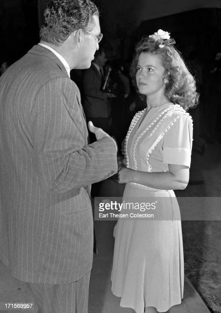 Actress Shirley Temple chats with film producer David O Selznick in 1944 in Los Angeles California