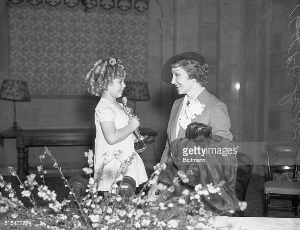 Actress Shirley Temple presents the Oscar for Best Actress to Claudette Colbert for her role in It Happened One Night
