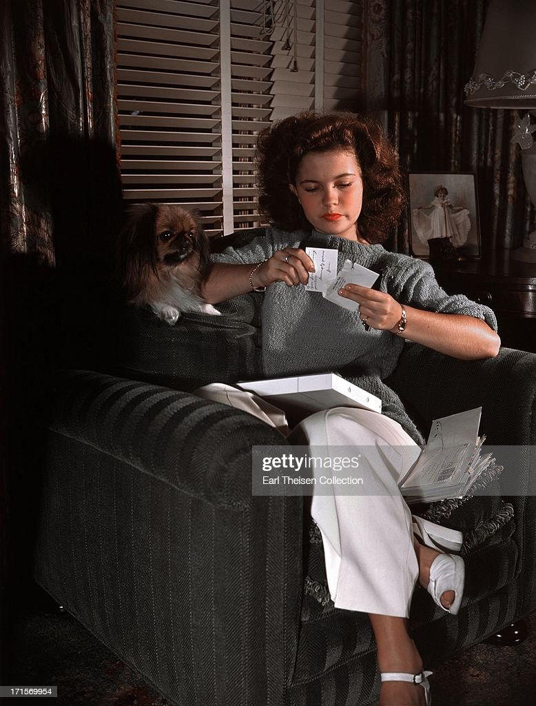 Actress Shirley Temple reads her fan mail at home in 1944 in Los Angeles, California.