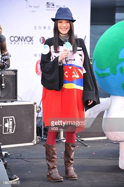 Actress Shu Qi attends a charity event to promote environment protection at Sanlitun Village on October 29 2011 in Beijing China