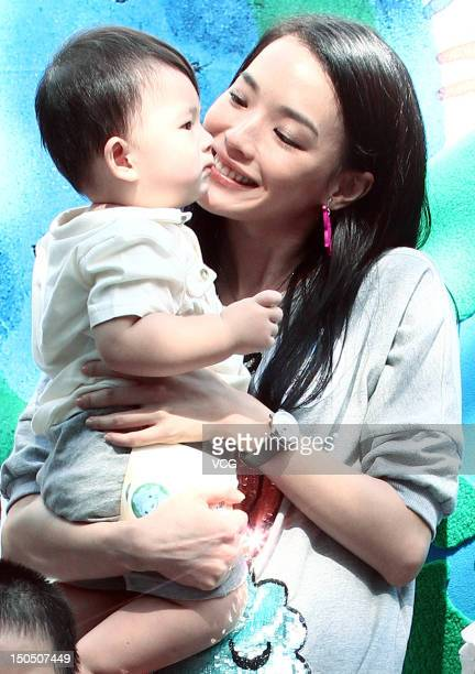 Actress Shu Qi attends a commonweal exhibition for disadvantaged children at the Huashan Creative Park on August 19 2012 in Taipei Taiwan