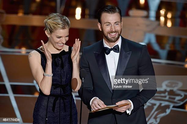 Actress Sienna Miller and actor Chris Evans speak onstage during the 87th Annual Academy Awards at Dolby Theatre on February 22 2015 in Hollywood...