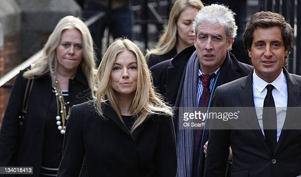 Actress Sienna Miller and and David Sherborne QC arrive to give evidence to the Leveson Inquiry at The Royal Courts of Justice on November 24 2011 in...