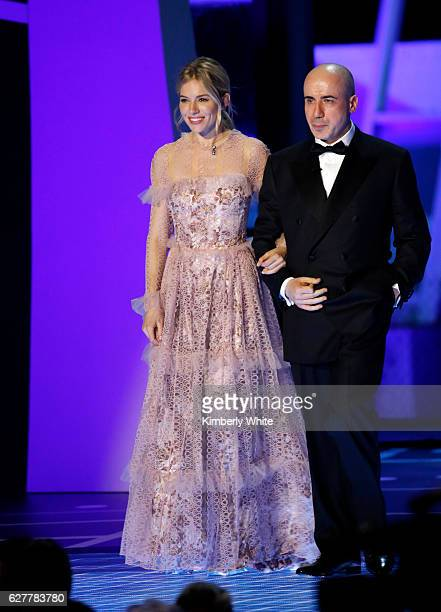 Actress Sienna Miller and Breakthrough Prize CoFounder Yuri Milner speak onstage during the 2017 Breakthrough Prize at NASA Ames Research Center on...