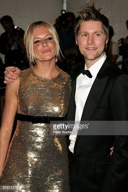 Actress Sienna Miller and designer and creative director of Burberry Christopher Bailey attend the Metropolitan Museum of Art Costume Institute...