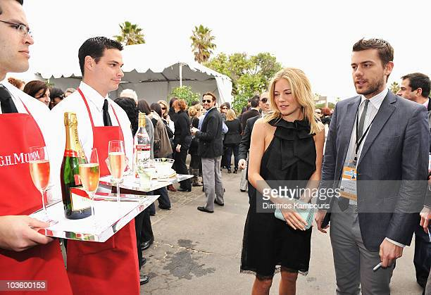 Actress Sienna Miller and guest at Stoli at the 2008 Film Independent's Spirit Awards at the Santa Monica Pier on February 23, 2008 in Santa Monica,...