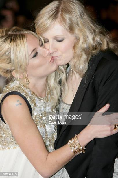 Actress Sienna Miller and her sister Savannah embrace at the UK premiere of 'Factory Girl' at Vue West End on March 13 2007 in London England