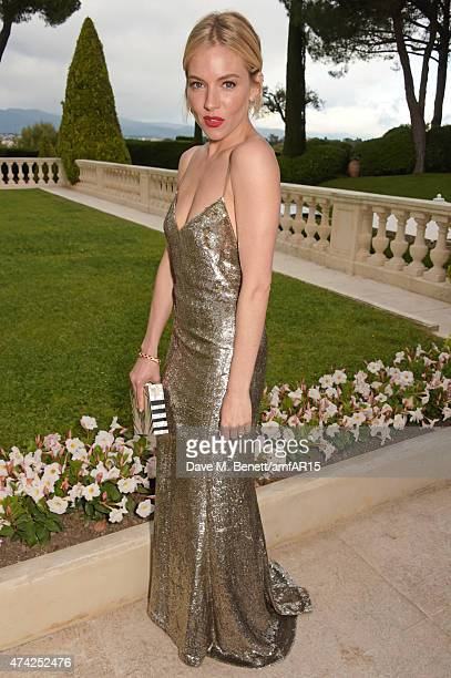 Actress Sienna Miller arrives at amfAR's 22nd Cinema Against AIDS Gala Presented By Bold Films And Harry Winston at Hotel du CapEdenRoc on May 21...