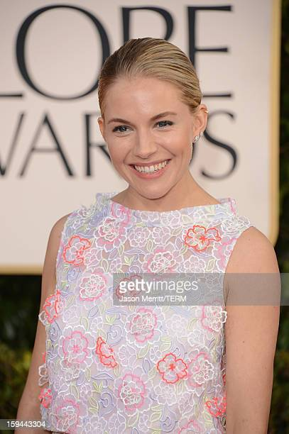 Actress Sienna Miller arrives at the 70th Annual Golden Globe Awards held at The Beverly Hilton Hotel on January 13 2013 in Beverly Hills California