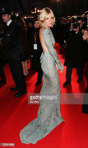 Actress Sienna Miller arrives at the Orange British Academy Film Awards at the Royal Opera House on February 11 2007 in London England