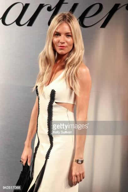 Actress Sienna Miller arrives on the red carpet for the Santos de Cartier Watch Launch at Pier 48 on April 5 2018 in San Francisco California
