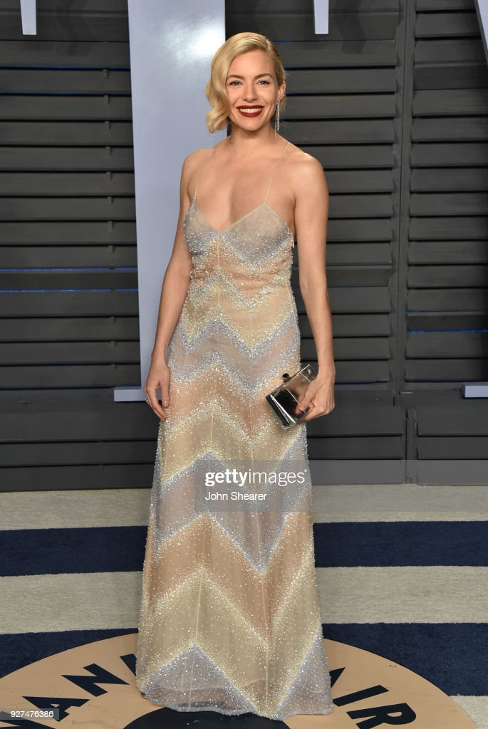Actress Sienna Miller attends the 2018 Vanity Fair Oscar Party hosted by Radhika Jones at Wallis Annenberg Center for the Performing Arts on March 4, 2018 in Beverly Hills, California.