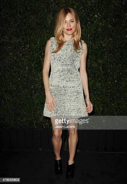 Actress Sienna Miller attends the Chanel and Charles Finch preOscar dinner at Madeo Restaurant on March 1 2014 in Los Angeles California