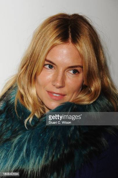 Actress Sienna Miller attends the Matthew Williamson show during London Fashion Week SS14 at on September 15 2013 in London England
