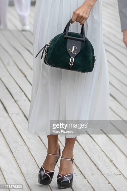 Actress Sienna Miller handbag and shoe detail poses next to the beach closet dedicated to her during the 45th Deauville American Film Festival on...