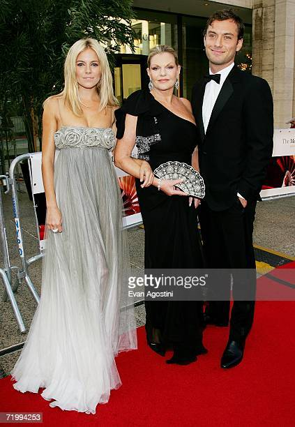 Actress Sienna Miller her mother Jo Miller and actor Jude Law attend the Metropolitan Opera 20062007 season opening night at Lincoln Center September...