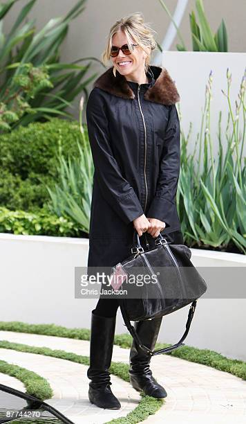 Actress Sienna Miller poses for a photograph during the Press and VIP preview day at Chelsea Flower Show at Royal Hospital Chelsea on May 18 2009 in...