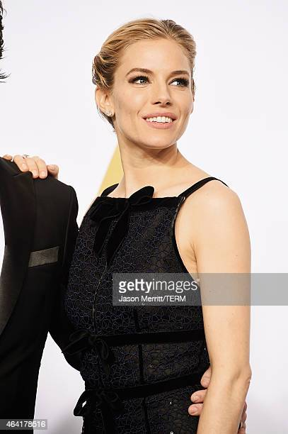 Actress Sienna Miller poses in the press room during the 87th Annual Academy Awards at Loews Hollywood Hotel on February 22, 2015 in Hollywood,...