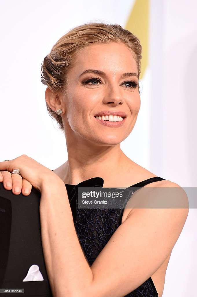 Actress Sienna Miller poses in the press room during the 87th Annual Academy Awards at Loews Hollywood Hotel on February 22, 2015 in Hollywood, California.