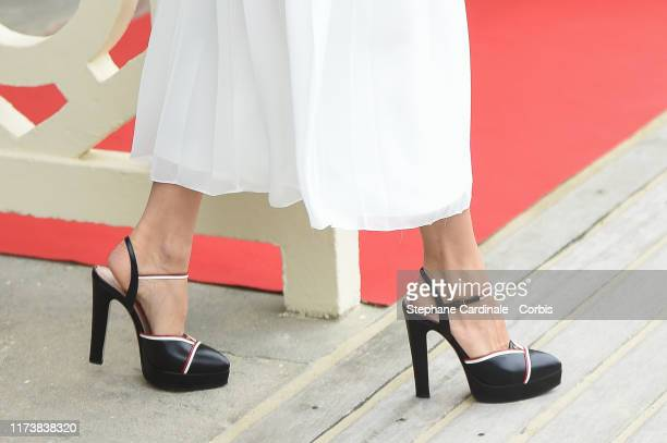 Actress Sienna Miller poses next to the beach closet dedicated to her during the 45th Deauville American Film Festival on September 11 2019 in...